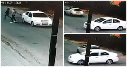 Quick-thinking driver escapes hijack by reversing into attackers' car