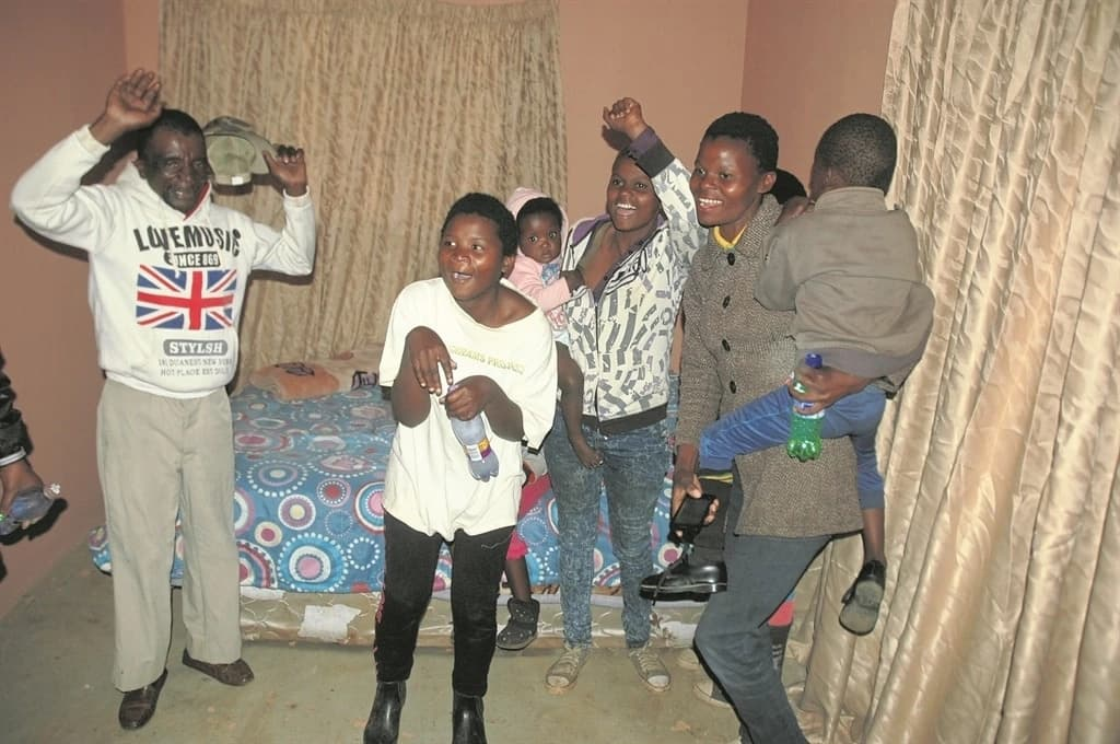 The family celebrates in their new informal dwelling. Source: Daily Sun/Phineas Khoza