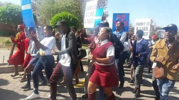 Some of the protesters marching to Afro Worldview's offices. Source: IOL