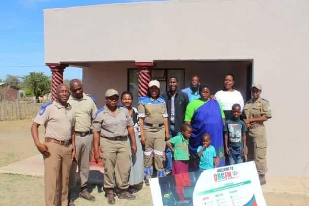 Traffic officers help build mom in need a new home