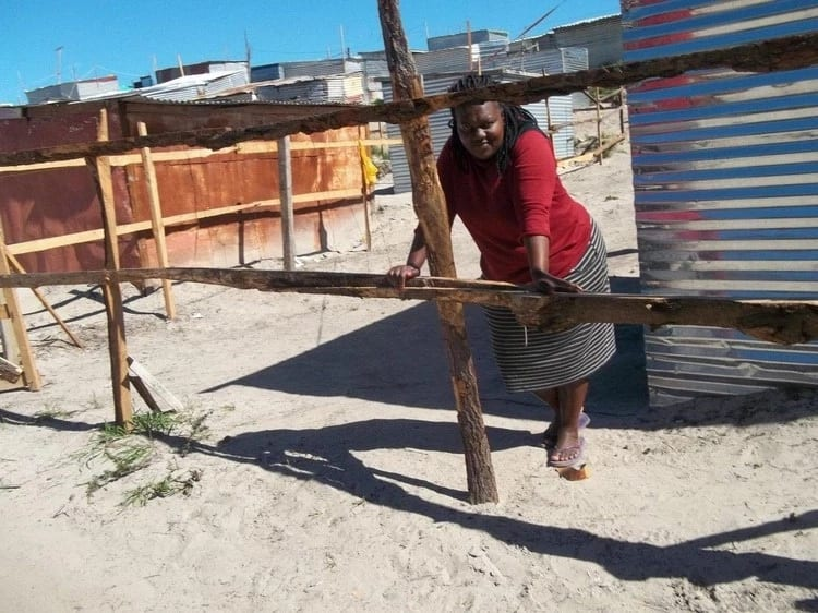 Linda Ggcwabe pictured outside her shack. Source: GroundUp