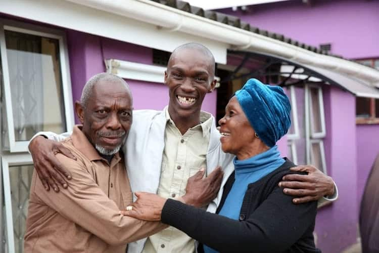 Njabulo pictured with his parents. Source: Times Live/Jackie Clausen