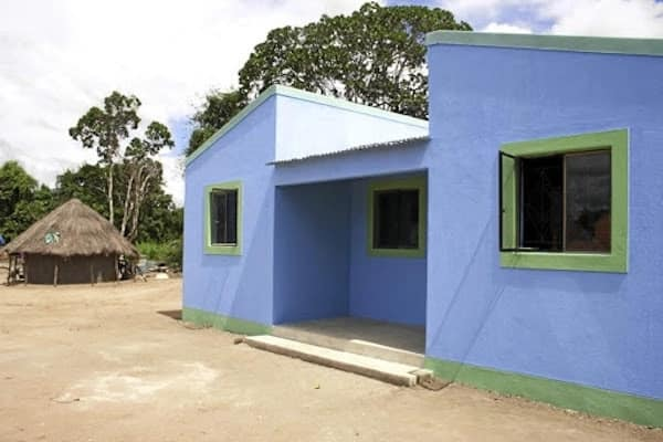 Machava's new house built next to the old one in rural Mozambique. Source: Sunday Times