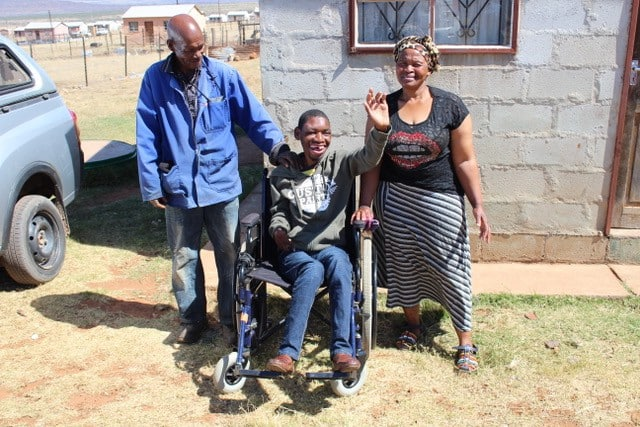 Zoliswa and her son Masibulele pictured with the latter's grandfather. Source: GroundUp