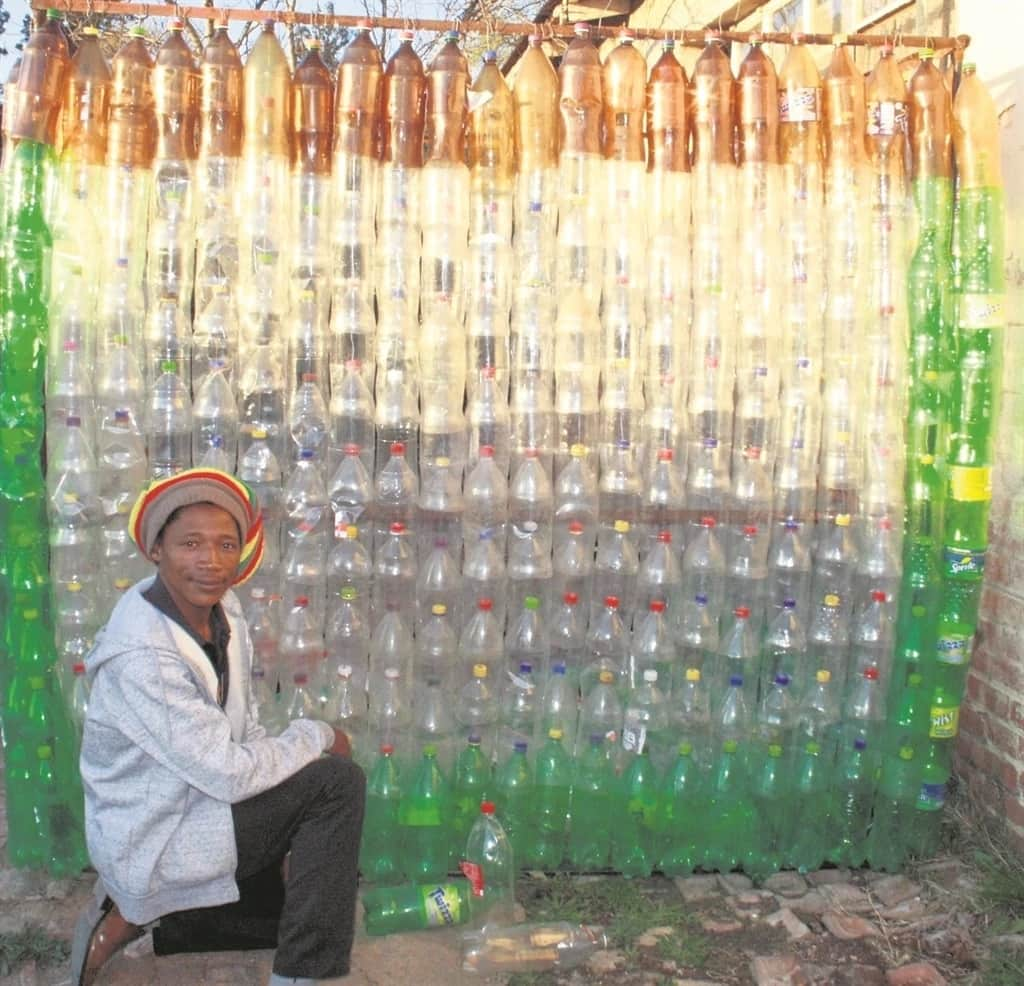 Lebo Makara poses beside his plastic fence. Source: Daily Sun/Nobathembu Zibi
