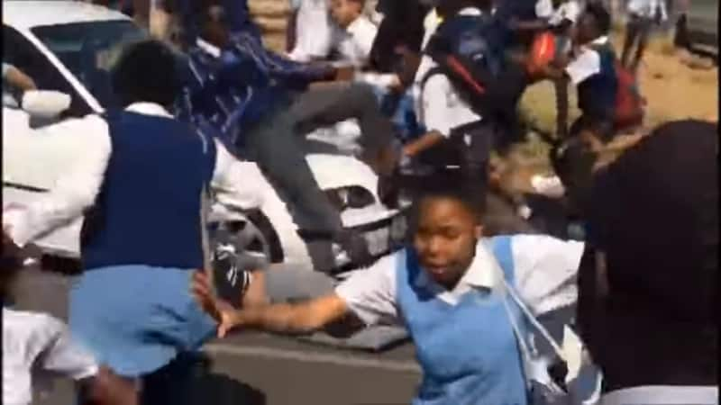 Video shows motorist ramming into school kids, who were blocking the road
