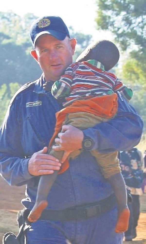 A rescuer carries the two-year-old girl. Source: News24