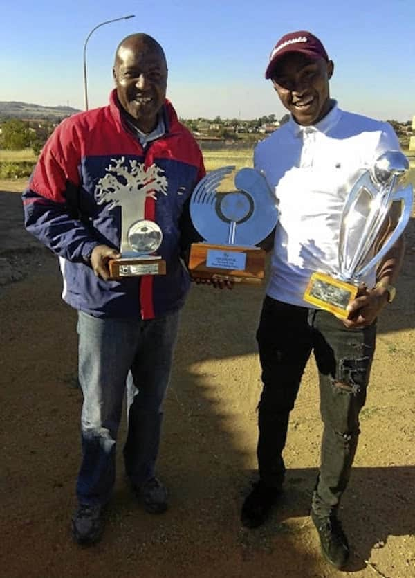 Sidwell and Lebohang Maboe pictured with the latter's awards. Source: Sowetan
