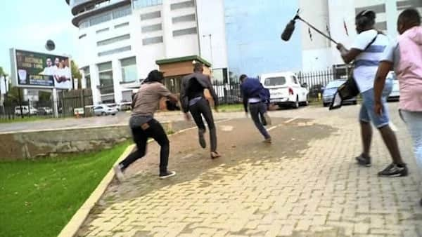 Karabo (in blue suit) ran from the scene when he realised what was going on. Source: Sowetan Live