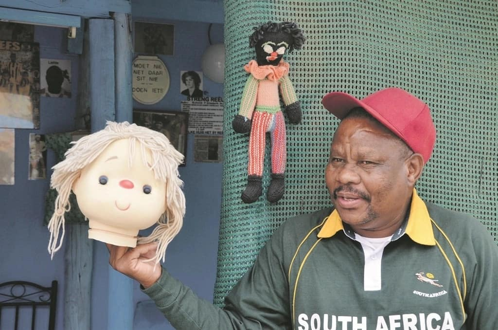 Kaleni claims his dolls protects him from witches. Photo credit: Daily Sun.