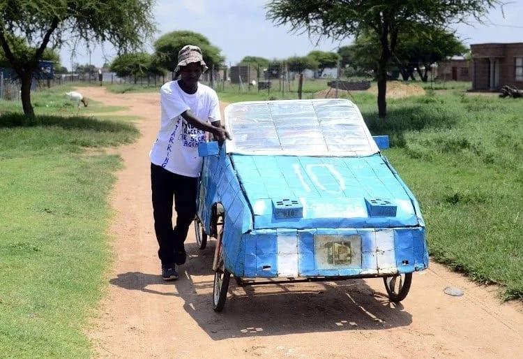 "Patrick Chweu stands next to his ""bicycle-car."" Source: Sowetan"