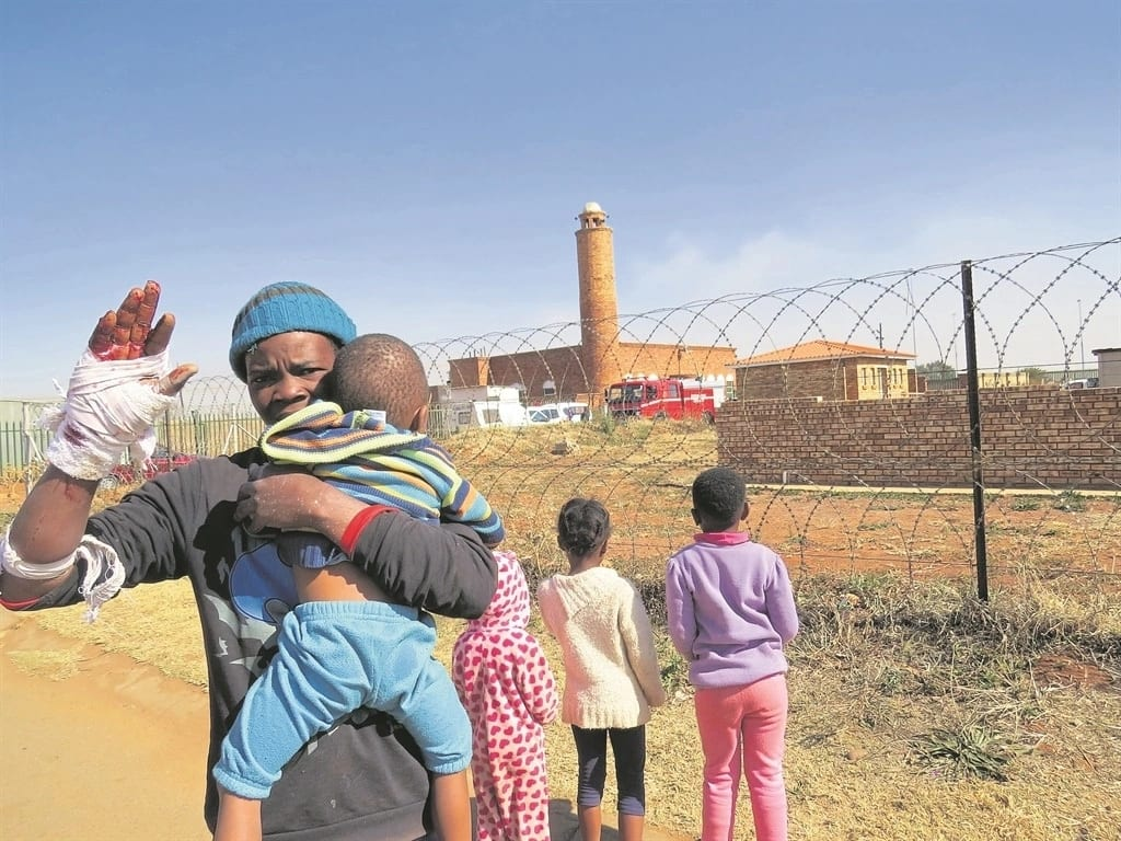 Thapelo Mosa pictured with the kids he rescued. Source: Daily Sun