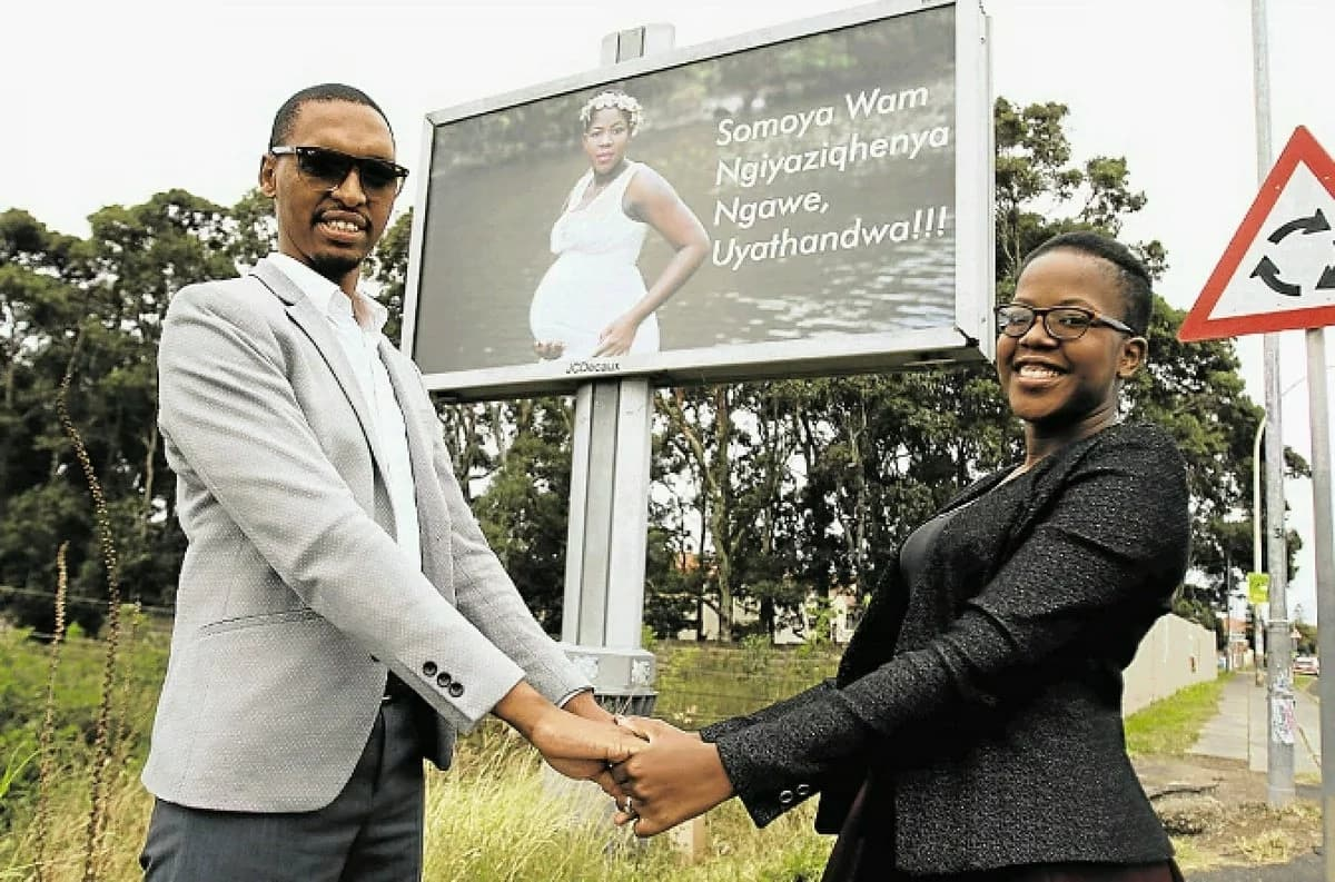 Nhlanhla Nxumalo and his wife, Sindiso, pictured next to their billboard. Source: Dispatch Live/Michael Pinyana