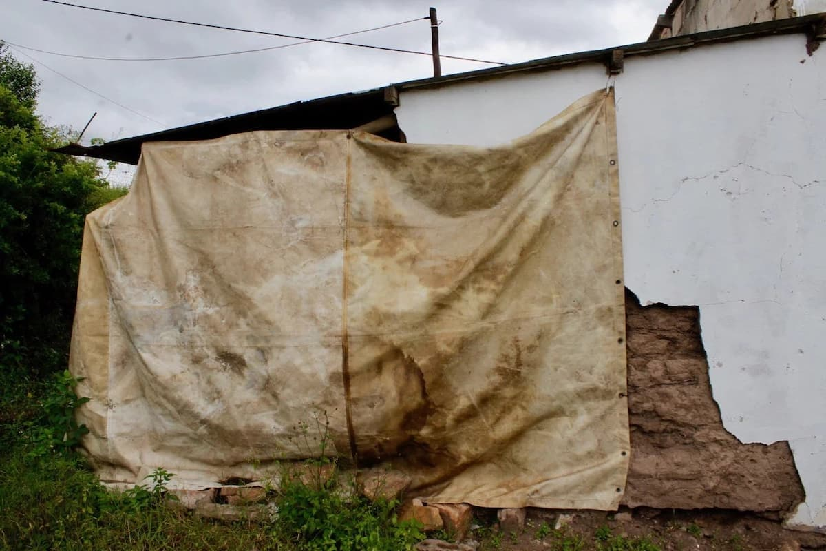 Their home was ruined during a storm in 2008. Source: GroundUp