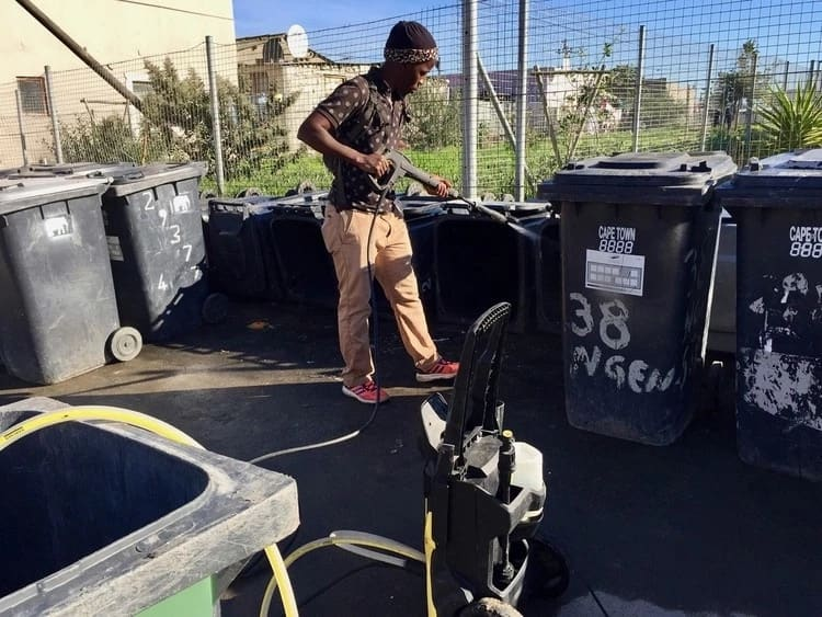 Bulela Moloi has built a thriving business by washing dustbins. Source: GroundUp/Peter Luhanga