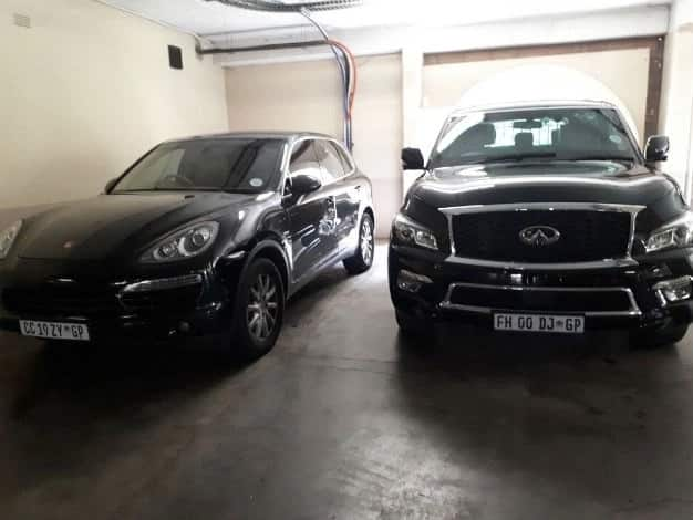 The Guptas Infinity QX80 and Porsche Cayenne parked at Oakbay. Photo: News24