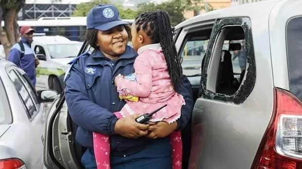Traffic cop hailed a hero after saving little girl, 3, from locked car
