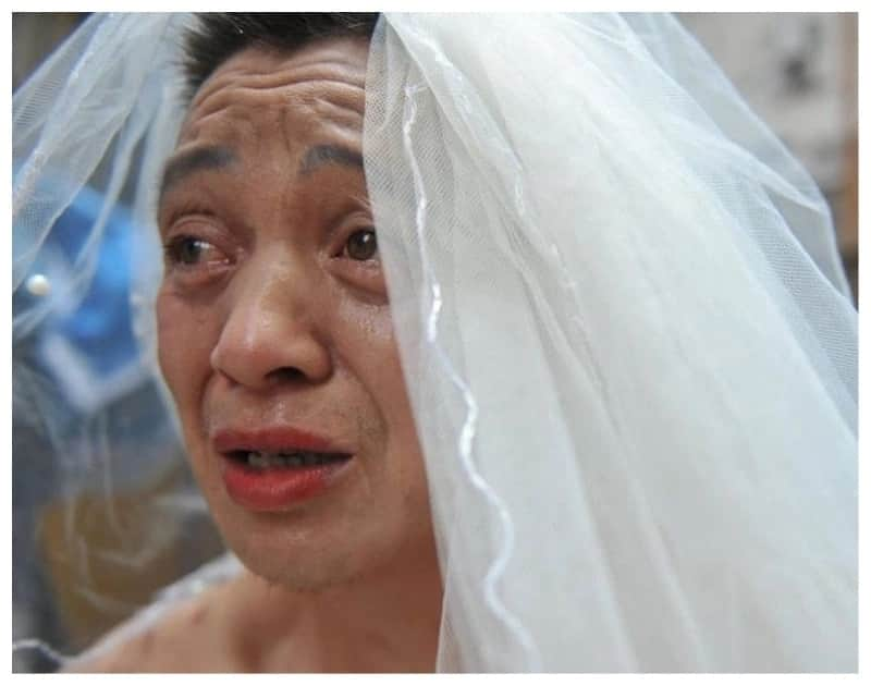 Desperate dad raises money for sick daughter by wearing wedding dress in public