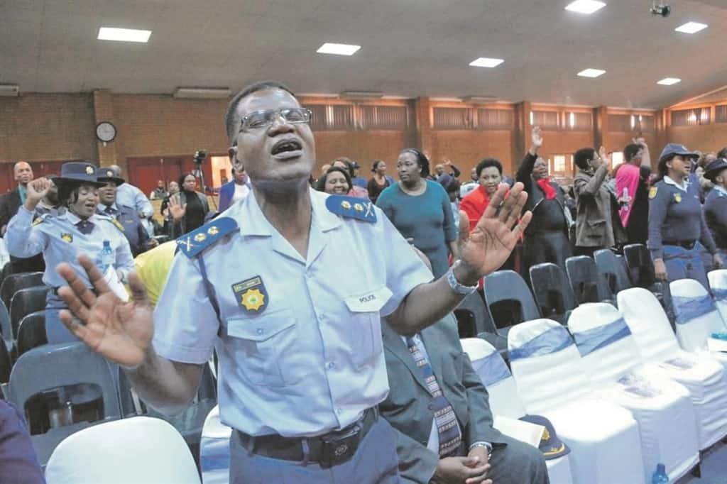 Ekurhuleni police officers gathered recently for a prayer session. Source: Daily Sun/Muntu Nkosi