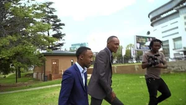 Karabo (left) with Moss Makwati after surrendering. Source: Sowetan Live