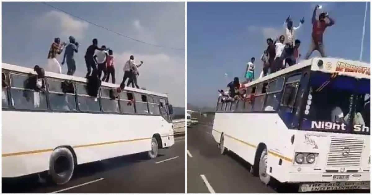 Viral video shows young men standing on the roof of a moving bus