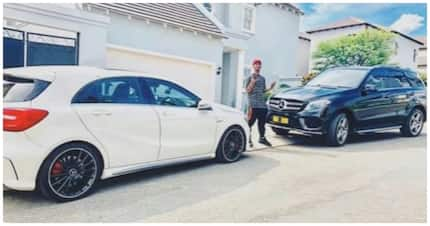 What a lot he got?: How many cars are in Emtee's garage?
