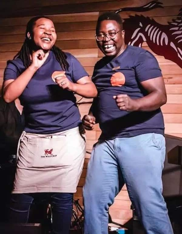 Deo (right) dances with a colleague. Source: backabuddy.co.za