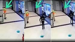 Video of security guard hiding from heavily armed robbers at ATM causes a storm
