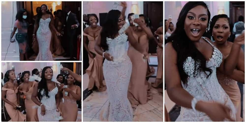 Bride makes majestic entrance into her wedding venue with bridesmaids raining cash on her in video