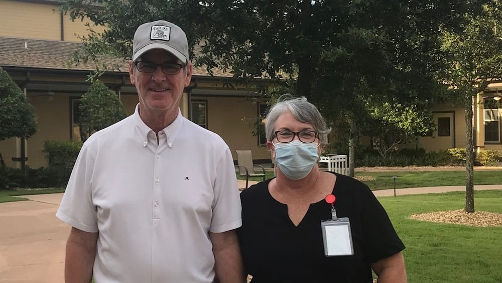 A woman separated from her husband by the Covid-19 pandemic got a dish-washing job at nursing home to see him.