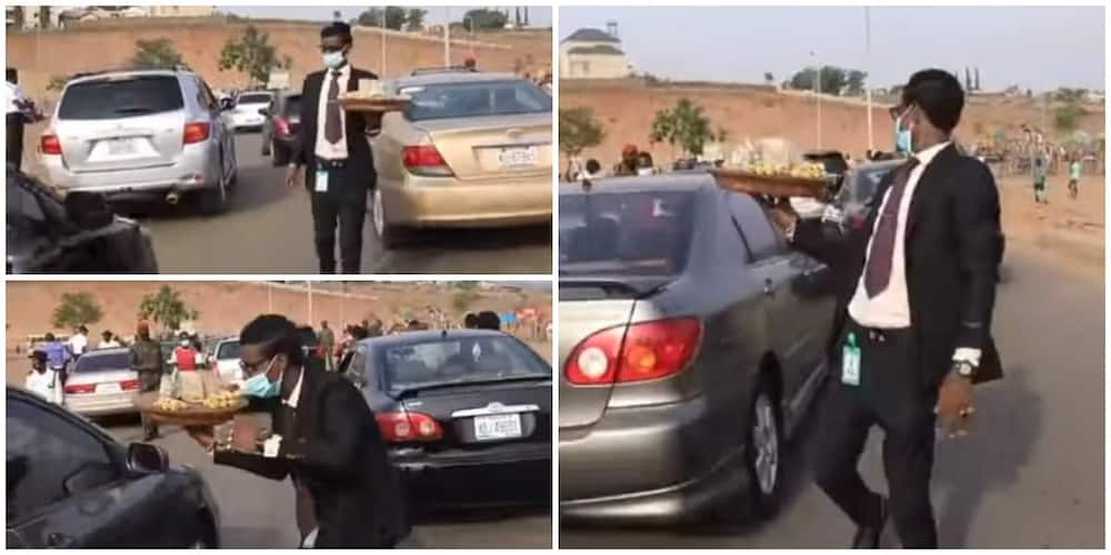 24-Year-Old Nigerian Man who Hawks Kolanuts Dressed in Suit during Traffic Finally Speaks, Says he Loves it