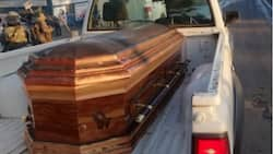 Coffin found but cops still on the hunt for 'missing' blue couch after looting