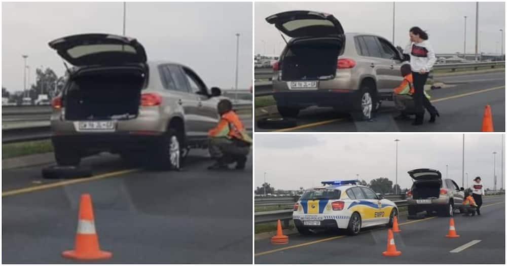 "Photos show cop helping woman change flat tyre: ""You're a hero"""