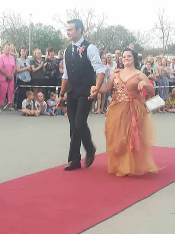 Young man takes his Down syndrome sister to his matric farewell