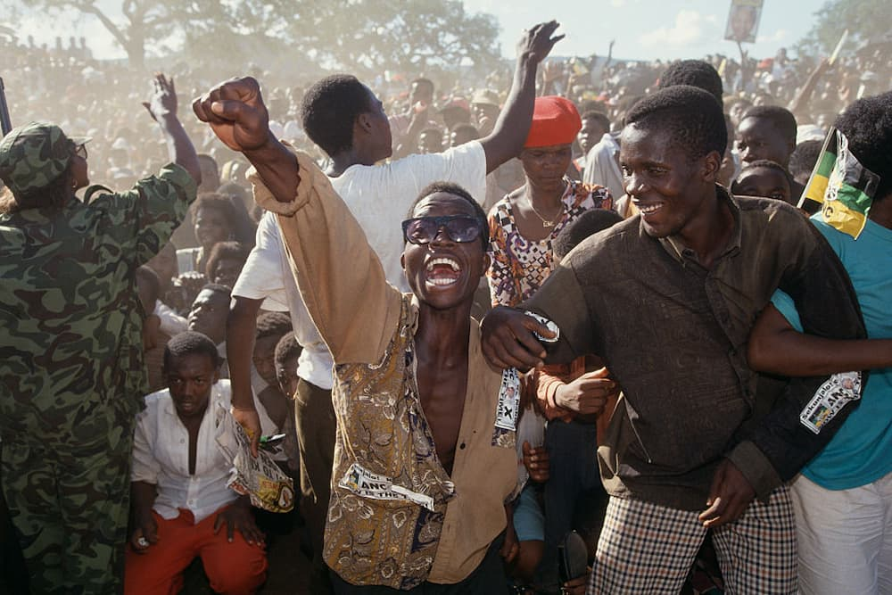 Nelson Mandela supporters cheering after the first free elections in South Africa in 1994. Image: Brooks Kraft LLC/ Sygma