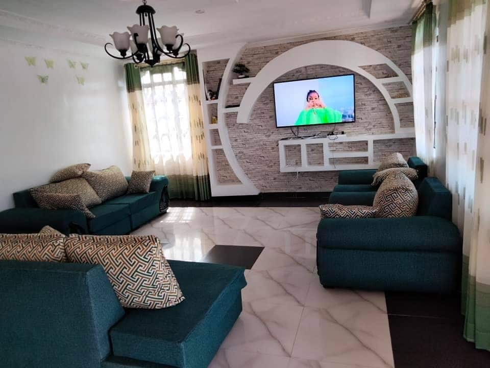 Nairobi dad, 32, who slept hungry as a kid builds palatial home for family