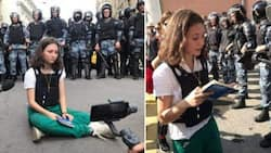 Young lady, 17, goes viral for reading constitution in front of riot cops