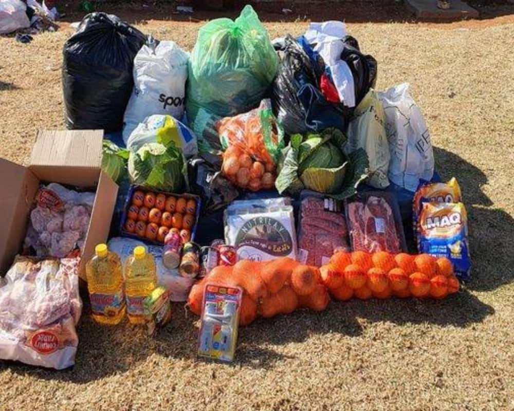 SAPS members donated clothing, bedding and groceries for a family whose home was ravaged by a fire. Image: Facebook South African Police Service