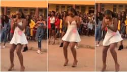 Lady wows with amazing legwork in heels while surrounded by people