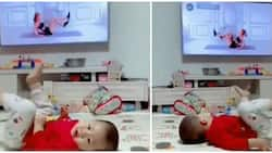 Adorable kid mimics lady doing exercise on television, video goes viral
