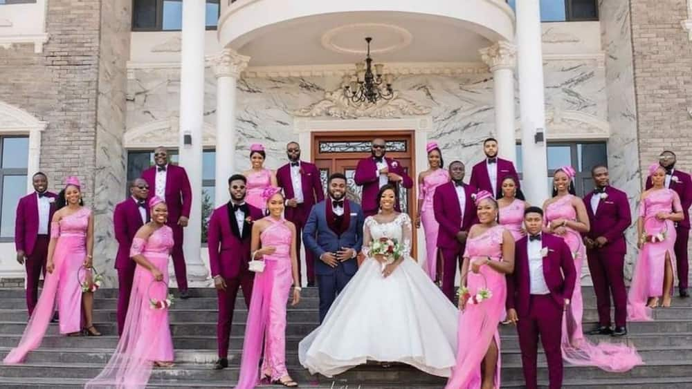 Adorable wedding photo lights up social media as couple and men in suits with bridal train showcase beauty