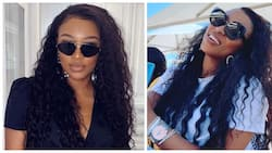 Oops momma: DJ Zinhle slips up and shows off preggie belly