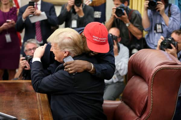 Kanye went in for a hug after receiving an official 'Make America Great Again' cap. Image Credit: Getty Images