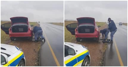 In photos: SAPS officers change woman's tyre in the rain