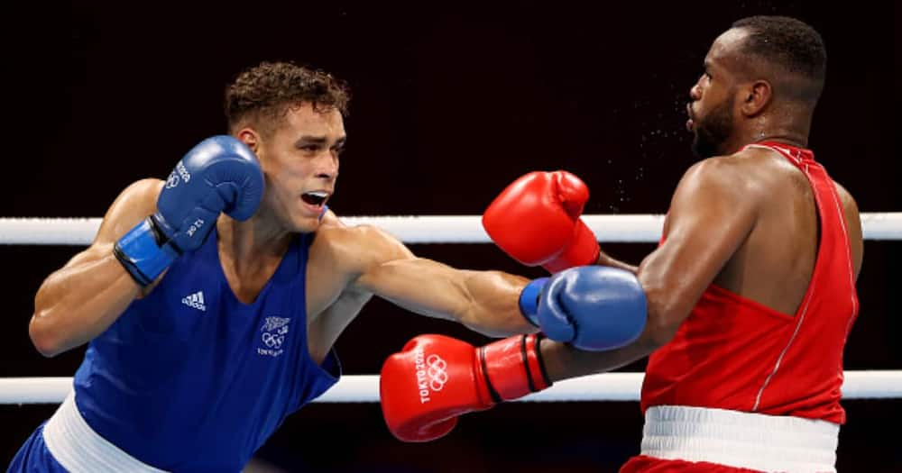 Youness Baalla (red) of Morocco exchanges punches with David Nyika of New Zealand during the Men's Heavy (81-91kg) during the Tokyo 2020 Olympic Games. Photo by James Chance/Getty Images)