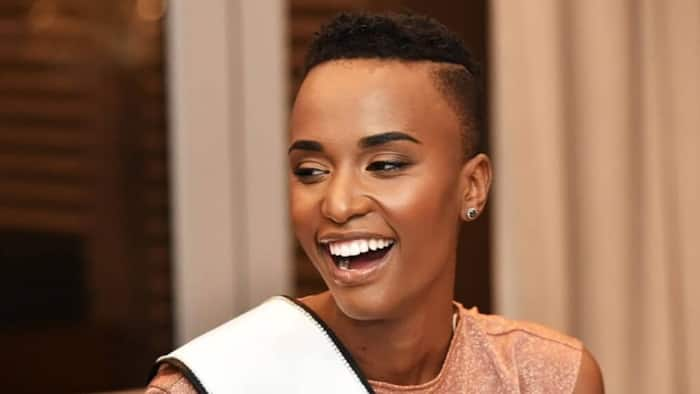 Zozi Tunzi swaps out her famous fade for a mullet, pays tribute to SA designer