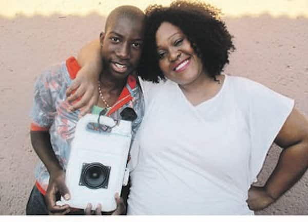 Olwethu Dineka holds one of his speakers. He's pictured with his mom Zandile. Photo credit: Daily Sun/Emily Mgidi