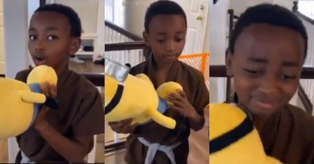 Adorable little boy teary-eyed after receiving sweet birthday gift
