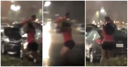 Video shows woman using her child to shield her weave from the rain