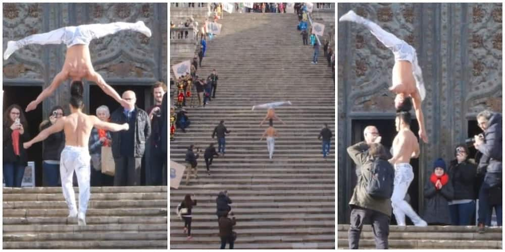 Talented man carries another person upside down firmly on his head as he climbs 90 staircases, video goes viral
